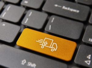 Fast shipping transport service concept: color key button with delivery truck icon on computer keyboard.
